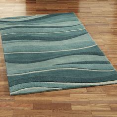 Ocean Landscapes Area Rug mimic the ocean waves in the wall painting, it is made of wool from India. Description from pinterest.com. I searched for this on bing.com/images