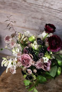 Dark glistening berries, green foliage and flowers going from dark red to deep pink to white. I like the dark romance of this esp for winter Fall Flowers, Fresh Flowers, Beautiful Flowers, Exotic Flowers, Purple Flowers, Floral Bouquets, Wedding Bouquets, Wedding Flowers, Wedding Colors
