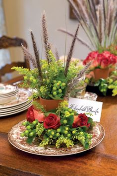 use vintage or old plates on each table.. put small pot of flowers, greenery  and/or feathers.. use as the small centerpieces. step by step tutorial  :)