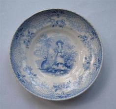 "Child's nursery dish with a young girl feeding 2 Rabbits. ""Juvenile, W & B"" (Wood & Brownfield 1838-1850)."