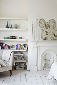 Shelves that float in an alcove rather than fill the space wall to wall