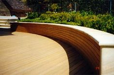 Sandstone and timber wall and decking. From a past project that won an award for Residental Landscape Construction by LNA (NSW). Designed and constructed by Joanne Green Landscape Design.