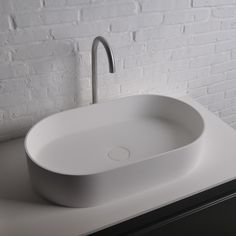 Ideavit Solidthin opbouw wastafel 60x35x12.5cm ovaal 0 kraangaten 1 wasbak Solid surface wit