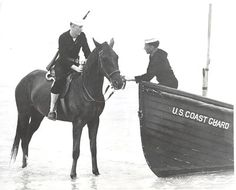 Coast Guardsman on horse patrol as he chats with his counterpart patrolling the beach in a motor surfboat. It is interesting to note that the surfboat is painted black to help disguise its presence. This was during the early period when the Coast Guard was experimenting with beach patrol by horse. Horses proved quite able and efficient and such horse patrols were adopted around the country Coast Guard Boats, Navy Coast Guard, Coast Guard Ships, Cost Guard, Coast Guard Stations, Military Police, Army, Pearl Harbor Attack, World War I