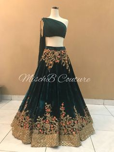 Bottle Green colored velvet silk wedding lehenga with matching color velvet silk choli and a bottle green georgette dupatta. Indian Dresses For Women, Indian Gowns Dresses, Indian Bridal Outfits, Indian Fashion Dresses, Dress Indian Style, Indian Designer Outfits, Pakistani Dresses, Fashion Outfits, Saree Fashion