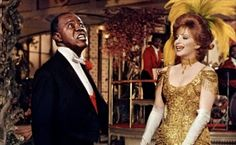 Louis Armstrong and Barbra Streisand in Hello, Dolly!.