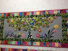 How beautiful is this wool/fabric appliqued quilt by Wendy Williams