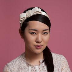 Ann - satin hairband with pearl encrusted taffeta bow. Cappellino Bridal