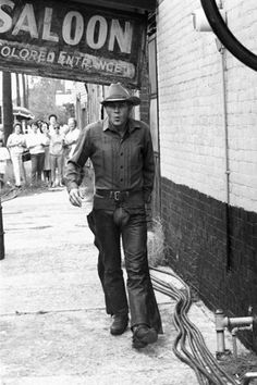 "Steve McQueen on location during the making of ""Nevada Smith"" - Note sign: ""Colored Entrance"""