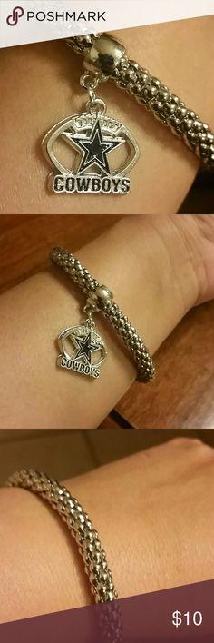 Dallas Cowboy bracelet NWT Dallas Cowboy silver bracelet. It has stretch to fit. Blue and silver cowboys football charm. Jewelry Bracelets