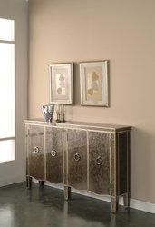 Pulaski 923080  Console Tiara Silver  W62 D12 H38  The Tiara Silver finish complements the glass top and door fronts. The glass panels are reverse painteda fine furniture treatment known as eglomise. Warm silvery outlines accent all cabinet edges. There are four doors with round pulls and one adjustable shelf within each side of the cabinet. This credenza is designed with a slim silhouette for use in high traffic areas.  Curtain Call Creations