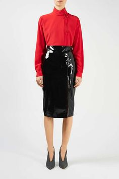 The Aubrey Blouse puts an updated spin on a ladylike '50s inspired silhouette. In vibrant red, this rebelliously chaste fold-over blouse ties daintily at the ruched neck. #Topshop