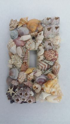 Decorate Light Switches Plates – Light switches plate is probably the plainest boring-looking piece of item in the whole room. Read Unique Ways to Decorate Light Switches Plates Switch Plate Covers, Light Switch Plates, Light Switch Covers, Seashell Crafts, Seashell Projects, Seashell Ornaments, Seashell Art, Beach House Decor, Home Decor