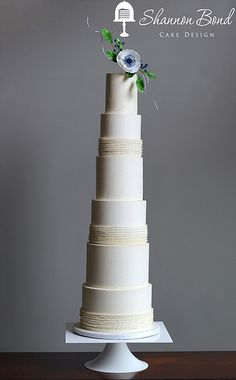 Couture Buttercream Wedding Cake by Shannon Bond Cake Design in Kansas City www.sbcakedesign.com  A tall, couture cake with delicate buttercream ruffles and sugar flowers and berries. Perfect for a contemporary wedding!