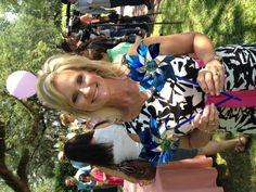 DCF Sec. Wilkins' wife Tanya holds blue pinwheels in support of child abuse prevention. #PinwheelsforPrevention
