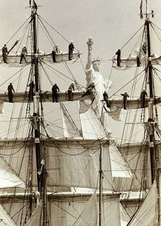 Great shot of the Statue of Liberty among sails and sailors on tall ship masts. | #NewYork #nyc #ny