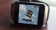An android-based Samsung Gear Live device running an emulator running Windows 95