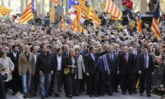 Catalan leader marches to court at head of huge flag-waving crowd - theguardian.com, 15 October 2015