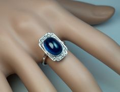 French Art Deco Sapphire Engagement Ring by RomanovRussiacom on Etsy https://www.etsy.com/uk/listing/244797622/french-art-deco-sapphire-engagement-ring