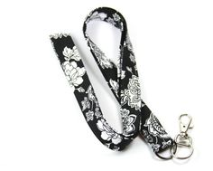This cute lanyard has beautiful black and white flowers. It is perfect for any occasion.  You can leave me a convoy if you need a different size.  You can have a wardrobe of lanyard to match your outfit. This lanyard is made of soft 100% cotton fabric to give a comfortable feel around your neck. This lanyard is easy to take care. You can spot clean and throw in a washer and hang dry. If you want you can iron and it is ready to use. These lanyards are perfect if you have metal allergy. Each…