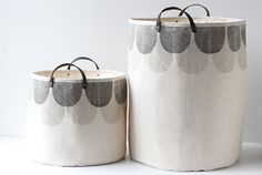 This large basket is great for storing and carrying laundry, towels, toys, knitting/craft projects, and more.  The exterior is made with a natural 100% linen and its lined with a 20 ounce natural cotton canvas. It does not have any boning or wire and is not rigid. It will hold its shape best when filled since it is a cloth bag, but the heavy canvas lining helps it stand up as shown in the image (it is photographed pressed with an iron and not stuffed). Has dark brown leather handles atta...