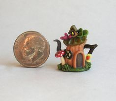 This miniature fairy house teapot is an original design and creation by artist C. Rohal. It is completely hand made, hand sculpted from polymer clay.  Removeable lid.  $28.50
