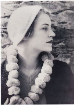 // Lee Miller with sea sponge necklace, Juan les Pins. Man Ray.