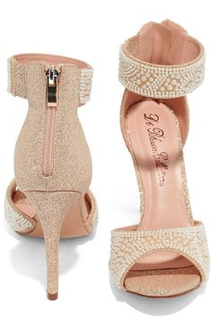 """Every modern day Cinderella needs the Ella Nude Pearl Ankle Strap Heels! Metallic gold and beige fabric is artfully decorated with faux pearls over a tapered toe strap, and ankle strap with a bit of elastic for fit. 3.5"""" heel zipper with gold pull."""