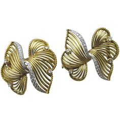 Cartier     Double Brooch | From a unique collection of vintage brooches at https://www.1stdibs.com/jewelry/brooches/brooches/