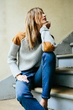 Cozy sweater with suede patches and true blue jeans