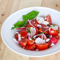 Simple tomato and basil salad… with a few radishes and feta cheese. You can also use goat cheese instead. Enjoy!