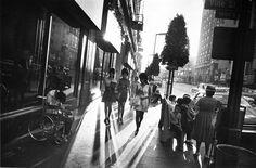 Garry Winogrand: Hollywood Boulevard, 1969 A disabled man, bent over in a wheelchair, captures the attention of three women walking by an...