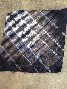 White tannin dyed over rust with shibori