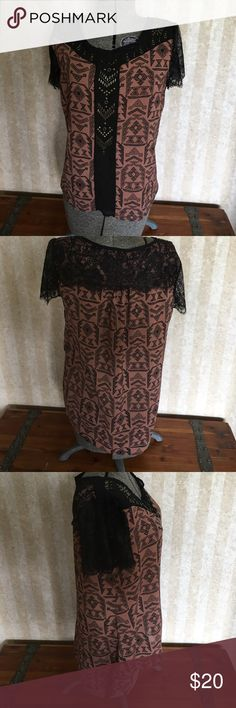 Daytrip print top with lace detail. Brown and black daytrip top with metallic beading. Lace cap sleeves. Longer in back. Two beads are missing at the bottom of design. Good condition other than that. Daytrip Tops Blouses