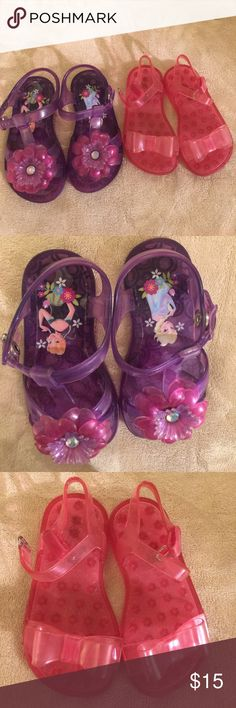 Two pair toddler jelly sandals One purple pair with Anna And Elsa and pink flowers with rhinestone center. Snap closure on ankle strap. Size 8. On pair pink with bow Gap brand size 7 Velcro close strap. GAP Shoes Sandals & Flip Flops