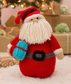 Huggable Santa Pillow Free Crochet Pattern in Red Heart Yarns -- This crocheted Santa is perfectly at home on the sofa, a shelf or the mantel, but kids may want to have him in their room watching whil (Diy Pillows For Him) Crochet Christmas Ornaments, Holiday Crochet, Christmas Pillow, Christmas Knitting, Christmas Crafts, Christmas Patterns, Christmas Decorations, Crochet Gratis, Crochet Amigurumi