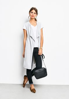 """Lightweight and oh-so versatile, this draped waterfall front cardigan is the perfect piece for building a chic, easy outfit. Layer over your favourite tee shirts, dresses and lightweight knits. •Easy, straight fit. Try your usual size. •Waterfall detail. •Edge-to-edge open front. •Sleeveless. •Sits on or above the knee depending on height. •Midweight knit. •Length 95.5cm (size S). •Model is 5'9"""" and wears size S...."""