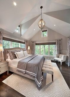 Transitional Master Bedroom with Pendant Light, Cathedral ceiling, Legends 500-Thread Count Duvet Cover, Wainscoting, Carpet