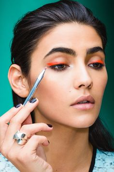 """4 New Year's Beauty Ideas That Are Bound To Make The Ball Drop #refinery29  http://www.refinery29.com/new-years-eve-makeup-looks#slide-19  """"This is really very simple,"""" promises Reiss-Andersen. """"Basically, we got this UV Aquacolor, which you can find at a beauty supply store, and applied it to the eye like a traditional liner. The only thing is, these products can be a little tricky if you've never played with them before. I recommend starting with a thin liner brush, wetting it, and then…"""