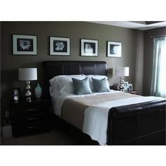 dark wall color and dark furniture, but the light bedding and other accessories help keep it light. color intergrated with pillows.