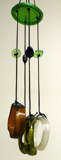 Like using the bottom of a bottle to hang chimes. Fused glass