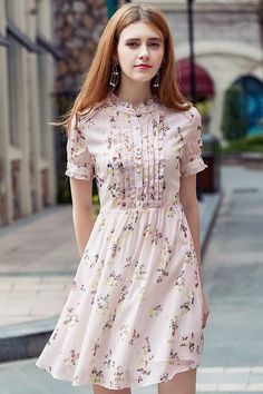 Detail: crew neck with ruffle trim, pearl buttons, front ruffles detailing, short-sleeved with ruffles on cuffs, hidden side zipper Fabric Stylish Dresses, Simple Dresses, Pretty Dresses, Casual Dresses, Short Dresses, Summer Dresses, Stylish Outfits, Kurta Designs Women, Kurti Neck Designs