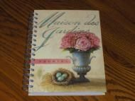 Price $4.97 Peonies is the picture on the front and back of this beautiful writing journal. Hard cover with wire bound binder. Simply a wonderful book...