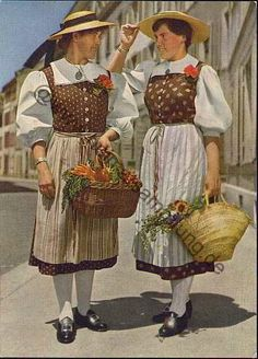 Two young woman wears the particular style of working dress for Basel,