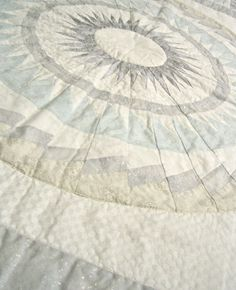 Stunning geometric silver & white Medallion Quilt by Malibu Quilts  http://www.etsy.com/shop/malibuquilts  $400.00