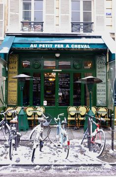 "Au Petit Fer a Cheval (the Horse Shoe Bar), Paris, France. ""a friendly, cosmopolitan locale that attracts a stylish clientele, and the couple of tables out on the pavement are desperately sought out as the rue Vieille du Temple is the Marais' main drag."" -- http://www.theguardian.com/travel/2009/apr/15/paris-pavement-cafes-bars-france"
