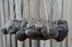 Suspended stones ~ I just love this. It makes me want to go hang rocks from my tree branches.