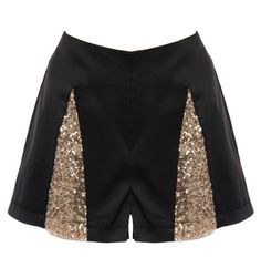 Harlequin Sequin Shorts: Shorts feature a lustrous satin shell with pocket-free backside and sleek seams throughout, symmetrical slivered gold sequin inserts to the front, and a concealed front zip closure to finish.