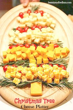 Every party needs a cheese tray! Simple way to display - some rosemary, cubed cheese and cherry tomatoes to create this beautiful and festive cheese tree!