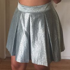 Pleaded mini skirt Forever 21 pleated mini skirt. Silver/blue frosty metallic. Never worn. No tag. Size L. Forever 21 Skirts Mini